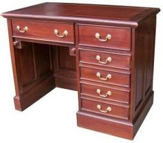 Kneehole desk with wooden top. This item is made from solid mahogany wood only sourced from sustainable plantations. In a wax polish finish with panelled sides and back. It is designed to house a computer therefore the top drawer above the knee hole is a