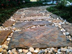 Flagstone pathway landscape traditional with stone river rock
