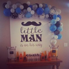 Little Man Baby Shower backdrop with balloon swag