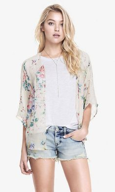 Finely draped fabric and a romantic floral design makes this kimono the must-have layer for spring. #Express #springfashion