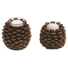 Two pinecone-shaped candleholders.           Product: Small and large votive holder    Construction Material: Compo...