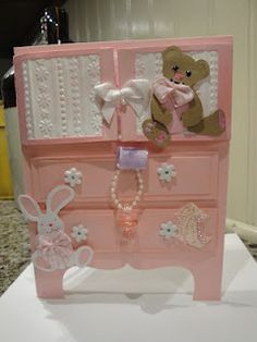 handmade baby card ... shaped card ... looks like a baby's chest of drawers ... cut adornments  .. pinks ... bunny and teddy bear ... adorable card!!