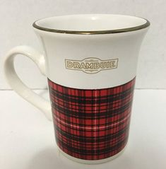 Vintage (c.1980s) Drambuie mug. Red and black Tartan, gold edge, Drambuie logo in gold. Made in England by Kiln Craft.