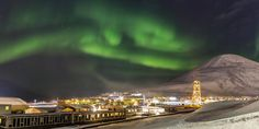 Welcome to Svalbard, an island realm with ice-covered fjords and glaciers, soaring mountains and unique wildlife that includes polar bears. An amazing location for aurora hunts, the capital Longyearbyen offers a wide range of northern lights experiences.