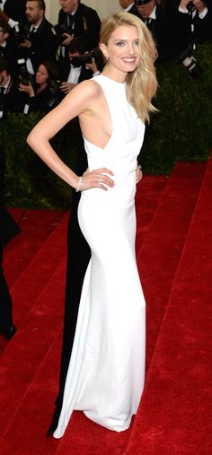 British model Lily Donaldson wearing a white double silk wrapped Burberry dress on the red carpet at the Met Gala