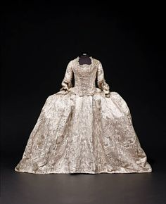 A rare and important Court Mantua and petticoat of ivory silk,French c. 1770...x