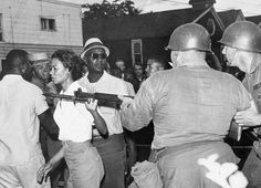 U.S. Mrs. Gloria Richardson, head of the Cambridge Nonviolent Action Committee, pushes a National Guardsman's bayonet aside as she moves among a crowd of African Americans to convince them to disperse, in Cambridge, Maryland, on July 21, 1963. // AP Photo
