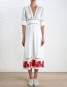 Zimmermann  Roza Border Panelled Dress, from our Summer Swim 16 collection, in White linen. Red embroidered rose floral detail at hem. Fitted bodice and waistband. Ladder insert trim through skirt, waistband, neckline, shoulder and sleeve. Centre back zip closure.