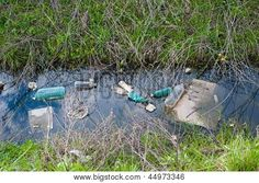 Concept or conceptual unhygienic polluted river,sewage or dirty water and grass with waste,trash and dump background Poster ID:44973346 Ecology, Grass, Recycling, Environment, Concept, River, Landscape, Plants, Poster