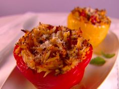 Get this all-star, easy-to-follow Orzo Stuffed Peppers recipe from Giada De Laurentiis