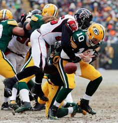 Green Bay Packers' Matt Flynn fumbles as he is hit by Atlanta Falcons' William Moore