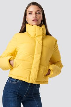 The Short Puffy Jacket by Hannalicious x NA-KD features a high neckline, zipper and snap buttons down the front, side slanting pockets, a padded design, and smooth lining. Yellow Jacket Outfit, Yellow Puffer Jacket, Puffy Jacket, Winter Coats Women, Coats For Women, Jackets For Women, Online Shops, Fashion Design Sketches, Padded Jacket