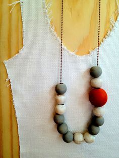 Here comes the sun, doot n' doo doo, and you'll be headed out of the grey. Hand-painted and distressed wooden balls in steel grey, white and persimmon are hanging with glee upon their 2.5 mm antique copper chain. This peace will rest at midriff on most. Sunny, sun, sun has just begun. $32