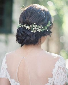 """Loving this messy bun detailed with tiny wax flowers! #weddinghair 