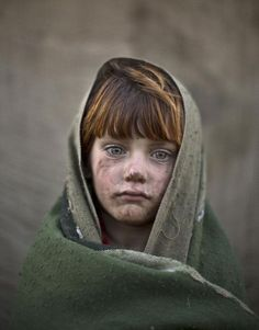 laiba Hazrat, age 6. Candid photos of Afghan refugee children playing in a slum on the outskirts of Islamabad, Pakistan.: