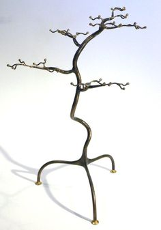 This beautiful sculpture tree is individually hand crafted and forged from steel, using blacksmithing techniques.  The techniques and process of creating used in making the piece, makes each tree a unique and distinctive craft object and functional work of art.  www.etsy.com/shop/mycreativesight  http://sharingourcreativeside.blogspot.com.au