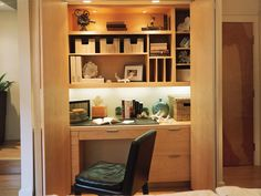 A closet in this transitional living room opens up to reveal a full home office in this design by Kristi Nelson. A built-in wooden desk and shelving provides plenty of storage and work space that can easily be hidden by closing the closet doors.