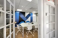 Office architectural & interior design realised by STIRIXIS Group for the renovation of Marine Tours SA. The meeting rooms are fully equipped to correspond to the company's needs. Environmental graphics are used for a transparent and vivid result. Office Interior Design, Office Interiors, White Office Furniture, Common Room, Meeting Rooms, Environmental Graphics, Strategic Planning, Furniture Making, Offices