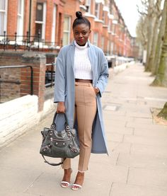 Flat, high-waisted pant, crop sweater, and duster