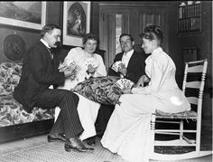 Alice Austen in the middle parlor of Clear Comfort playing cards.