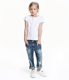 Denim blue. 5-pocket, loose-fit jeans in washed denim with heavily distressed…