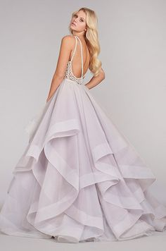 A stunning lavendar wedding dress features a full textured skirt and bare back detailed with a crystal design.