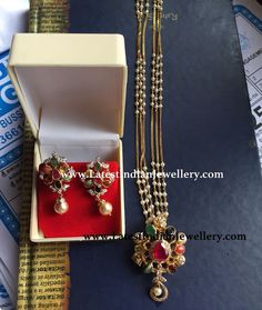 Beautiful navaratna pendant and earrings set paired with light weight beads gold chain. Simple and trendy gold chain with pearl beads Indian Jewelry Earrings, Jewelry Design Earrings, Gold Earrings Designs, Bead Jewellery, Jewellery Designs, Pearl Necklace Designs, Pearl Necklace Set, Marriage Jewellery Set, Gold Haram