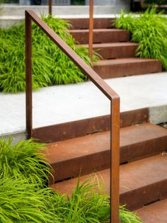 How do you solve a problem like Earth Inc.? This front yard had a severe slope! We addressed this issue by creating two concrete slab landings suspended above grade on pier footings that seem to float on a bed of Japanese forest grass (#Hakonechloa). Linking these two landings are two sets of corten steel stairs. Just for fun we integrated a bench on the upper landing to relax after a long day. #myToronto, #frontYard, #problemSolved…