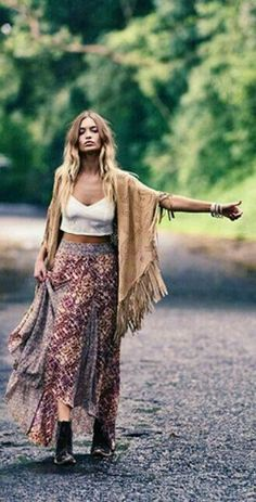Hitchhiking in the forest. Flowy cape and dress that are made of dreams. super cute crop top that looks stylish and comfortable.