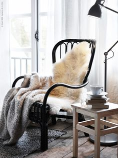 Create a cozy corner in your bedroom with a comfortable chair, a soft throw, and a place to set a warm drink - the ideal spot for meeting your favorite novel for a date.