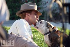 Ryan Gosling: Puppy Love — The actor, in mid-century costuming, makes friends with a bulldog on the set of his new movie with Emma Stone, The Gangster Squad. i'm in love