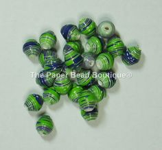 This ad is for a lot of 25 loose paper beads handmade by me! These beads measure 1/2 wide and have been rolled on a 1/8 beading tool into a cone shape. Ive used a heavy scrapbook cardstock for this bead so they are a bit chunkier! Theyve been made out of a high quality scrapbook paper in Seattle Seahawk team colors in an argyle design! All of my beads have been hand cut, hand rolled and then sealed, one by one, to protect the paper and give them a gloss. These beads are water resistant, NOT…