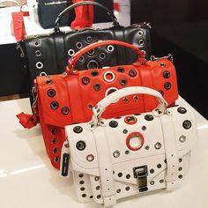 Proenza Schouler grommet-studded bags