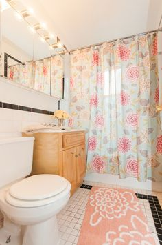 The perfect girly bathroom. Great lighting, pastel colors, and floral print. This Chicago apartment is ready for Spring. #bjbproperties #goldcoastapartments #chicagoapartments