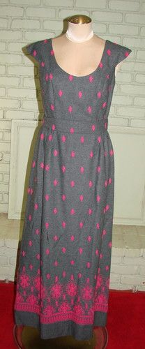 """Gorgeous wool dress from Midge Grant UK designer. Scoop neck with a cap sleeve. Natural waist with a fabric tie. Long back zipper, Full maxi skirt with dark pink embroidery. Diamond shapes on most but more flowers on hem. Dress is in excellent condition. $71.00  Measurements Bust                36"""" Waist             28"""" Hips               42"""" Length            57"""""""