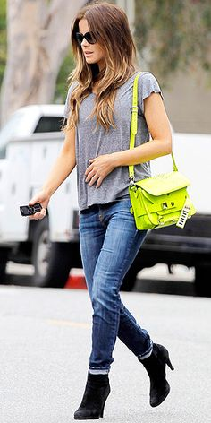 Kate Beckinsale in jeans and grey t-shirt with neon yellow Proenza Schouler crossbody bag.
