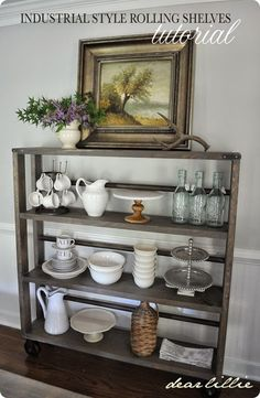 Dear Lillie shares how to make your own industrial rolling shelf inspired by Restoration Hardware for $125 instead of thousands! It works beautifully as a bookshelf or open dining storage shelf.