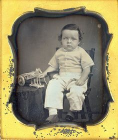 Young Boy in New Shoes and Toy by Mirror Image Gallery, via Flickr