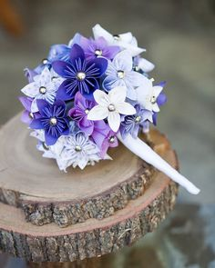 Mcknelly Mcknelly Werkley you could rock this bouquet if you don't want to do real flowers. Very vintage. Paper Wedding Decorations, Paper Flower Centerpieces, Paper Flowers Wedding, Purple Wedding Flowers, Paper Flowers Diy, Wedding Paper, Real Flowers, Origami Flower Bouquet, Paper Bouquet