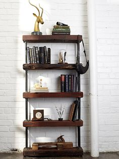 Many of today's most popular DIY bookshelf projects involve galvanized pipes. The Industrial Rustic Bookshelf celebrates this design choice, along with the use of reclaimed wood for an earthy warmth. Check out the full tutorial at HGTV: