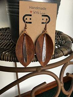 Large Leather Earrings, Brown Leaf earrings with brass te... https://www.amazon.com/dp/B07BKRLLXK/ref=cm_sw_r_pi_dp_x_PHcSAbSTA96X0