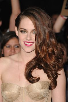 Where: The premier of The Twilight Saga: Breaking Dawn – Part 2, 2012  The style: Stewart looked very glamorous on the red carpet with side-swept, glossy, tousled locks.