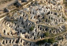 PHOENICIA - Aerial view of the Tuvixeddu Phoenician necropolis in Sardinia, Italy. Places Around The World, Around The Worlds, Rome, Phoenician, Archaeological Site, Aerial View, Dream Vacations, Italy Travel, Land Scape