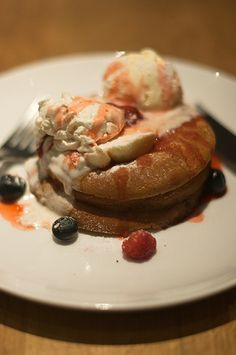 Pancakes with ice cream and berries