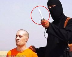"""The beheading of captured American journalist James Foley by a British ISIS terrorist known as """"Jihadi John,"""" in a still from propaganda video footage posted on Youtube."""
