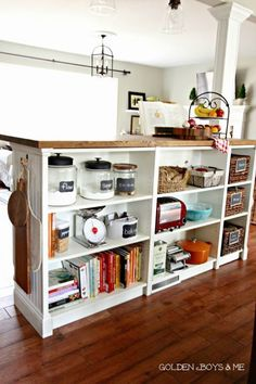 Bookshelves Turned Kitchen Island IKEA Hack The IKEA Billy Bookcase was used for this GENIUS hack… It was created as a room divider and uses an IKEA butcher block for the top surface!… I need to calm down! Kitchen Island Ikea Hack, Kitchen Island Storage, Kitchen Hacks, Kitchen Islands, Kitchen Ideas, Kitchen Organization, Organization Ideas, Kitchen Counters, Room Kitchen