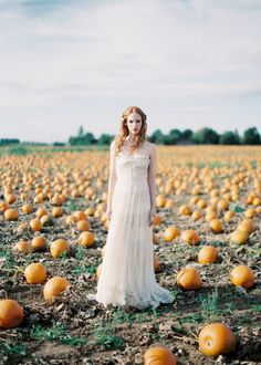 Another great idea for an engagement/wedding invitation shoot, field of pumpkins with us dressed up.