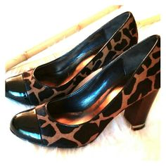 """Ann Taylor Calf Hair- Giraffe Heel *This exotic heel is so classy!  It is made of authenic calf hair.  It is tan and black, with a beautiful detailed giraffe design.  It has a patent leather round toe, an approx 3 1/2"""" dark brown wooden heel, with gold detail around the base.  The heels have a few nicks, from normal wear.  Overall in great used condition.  Beautiful shoe!* Ann Taylor Shoes Heels"""