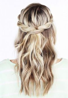 Loose waves pulled back in a messy braid. So cute!