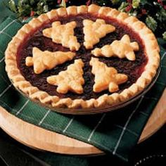 "Easy Cranberry Pie Recipe -""AS A SPECIAL TREAT when making this pie, Mom would sometimes place a marshmallow in the center of each lattice square, or, in honor of the Christmas tree we had just brought home, she'd cut Christmas tree shapes from the pie dough and place them on top of the pie."""